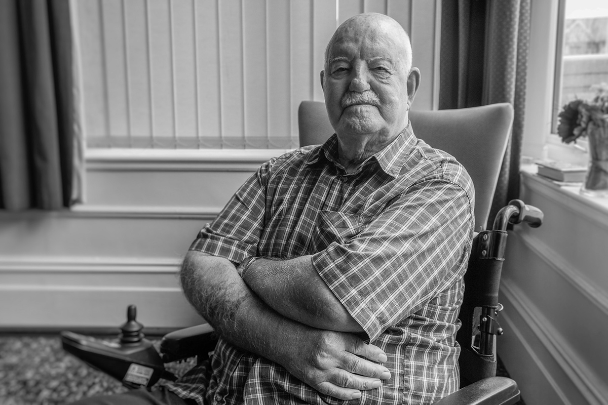 Monochrome portrait of BLESMA resident Ernie Beale