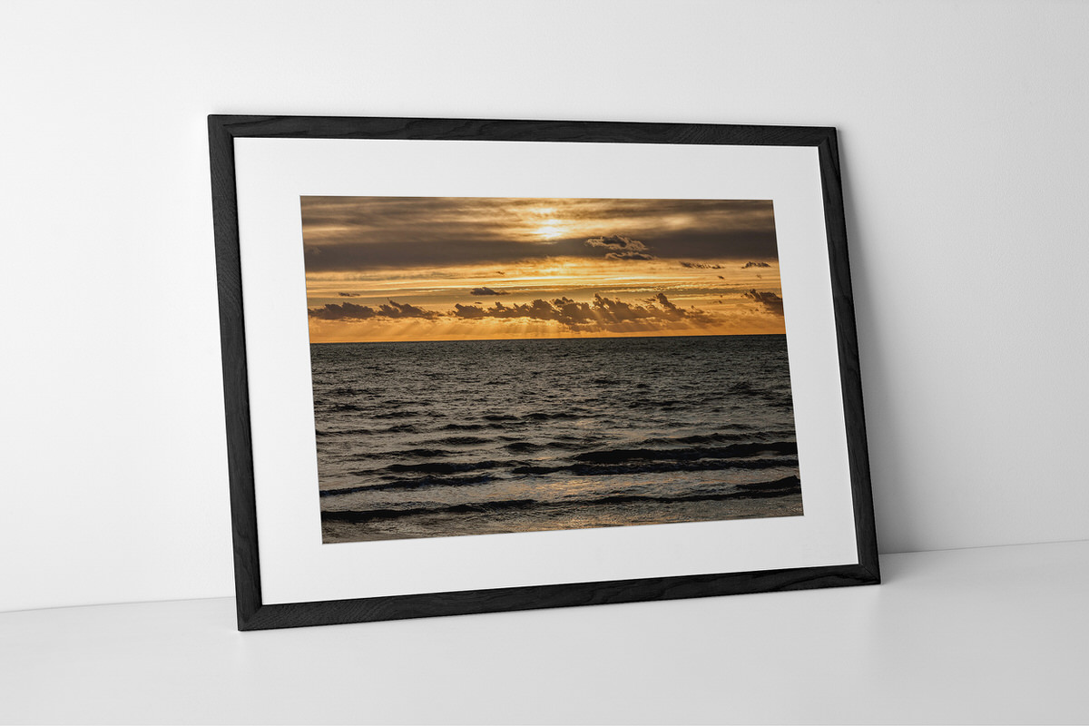 Seaside Sun Rays Print In Black Picture Frame By Yannick Dixon
