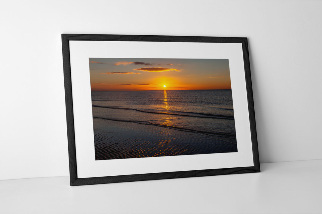 Golden Seaside Sunset Photographic Print In Black Frame By Yannick Dixon