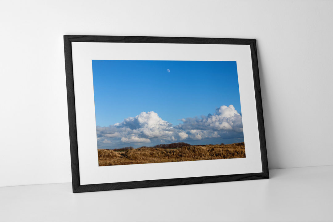Mid-Afternoon Gibbous Moon Print Presented In Black Frame By Yannick Dixon